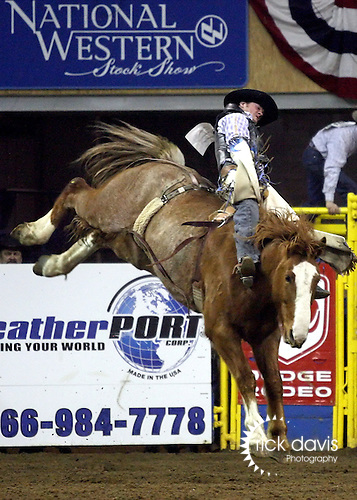 1/18/09--Photo by Rick Davis--PRCA cowboy Joe Gunderson of Agar, South Dakota scored an 81 point bareback bronc ride on the bronc Major Disaster PRCA cowboy Paul Jones of Elko, Nevada scored an 83 point ride on the Calgary bronc Cosmic Wake during action at the 103rd National Western Stock Show and Rodeo in Denver, Colorado.