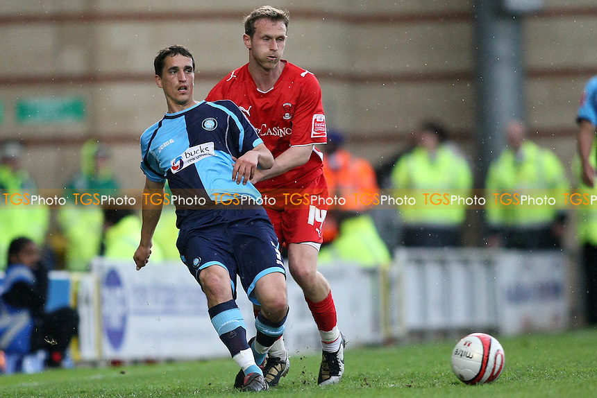 Craig Woodman of Wycombe and Ryan Jarvis of Orient- Leyton Orient vs Wycombe Wanderers - Coca Cola League One Football at Brisbane Road, Leyton, London - 01/05/10 - MANDATORY CREDIT: George Phillipou/TGSPHOTO - Self billing applies where appropriate - 0845 094 6026 - contact@tgsphoto.co.uk - NO UNPAID USE..