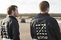 Workers watch as self-driving car testing already goes on as road constructions are still in progress during a press visit at the Zone test track aimed to support development of autonomous self-driving vehicles in Zalaegerszeg (about 220 kilometres South-West of capital city Budapest), Hungary on Nov. 12, 2018. ATTILA VOLGYI