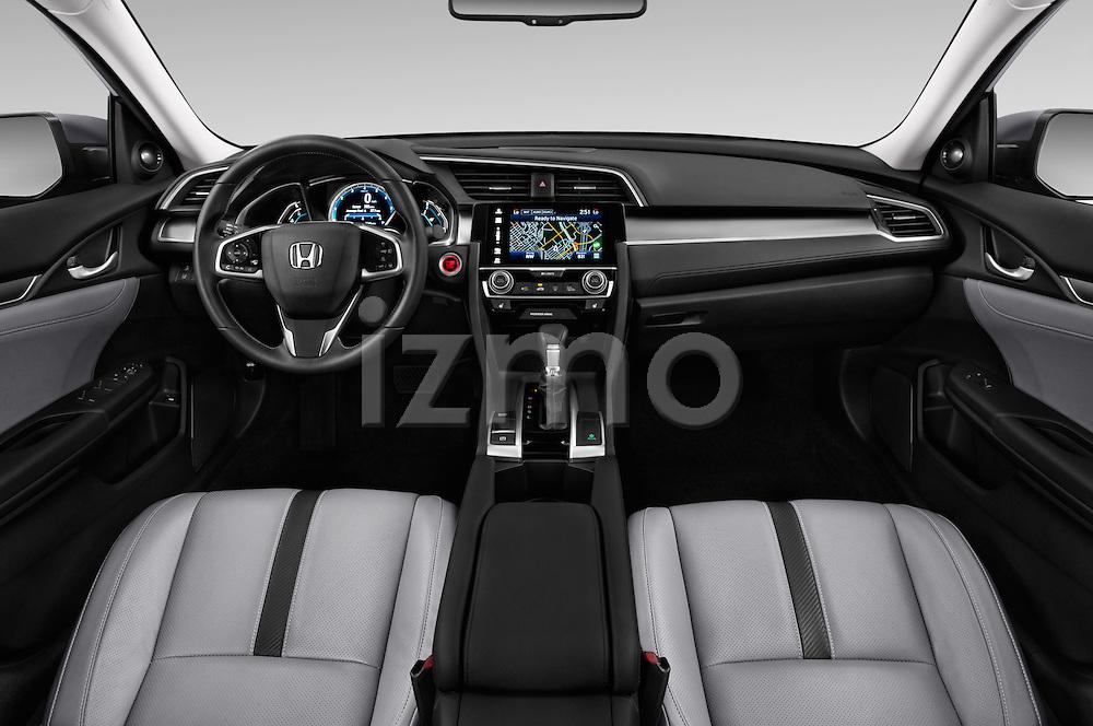 Stock photo of straight dashboard view of 2016 Honda Civic Touring CVT 4 Door Sedan Dashboard