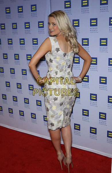 Holly Madison.Las Vegas Celebrities celebrate equal love at the 8th Annual Human Rights Campaign Dinner Gala at Aria Las Vegas, Las Vegas, Nevada, USA, 18th May 2013..full length hands on hips sleeveless grey gray yellow print patterned back rear behind over shoulder .CAP/ADM/MJT.© MJT/AdMedia/Capital Pictures