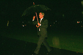 United States President George W. Bush arrives at the White House in Washington, DC in the rain after a trip to Texas, Arizona, and Colorado on November 29, 2005.  <br /> Credit: Dennis Brack / Pool via CNP