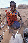 A Samburu woman  blacksmith.   Maralal.  Northern Kenya...The  blacksmith  clan is  outcast from the other Samburu communities,  their trade seen as sinister and dangerous  ....
