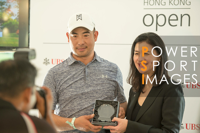 Winners get their prize out of the hands of UBS Hong Kong Country Head Amy Lo at the end of the Am-Am tournament of the 58th UBS Hong Kong Golf Open as part of the European Tour on 13 December 2016, at the Hong Kong Golf Club, Fanling, Hong Kong, China. Photo by Marcio Rodrigo Machado / Power Sport Images