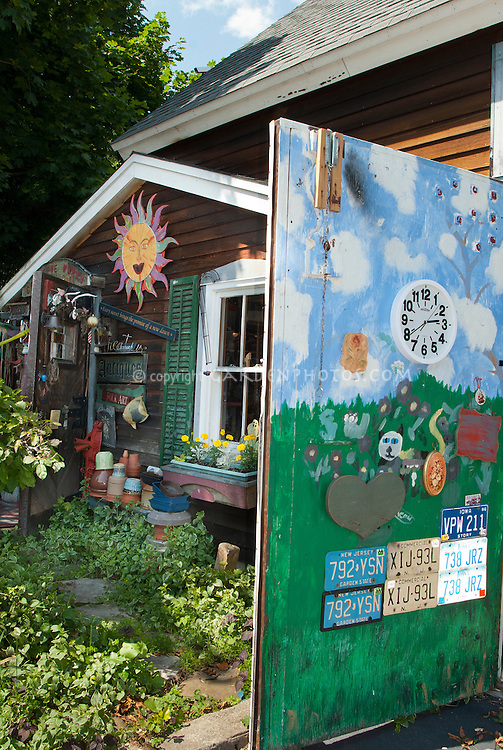 Whimsical painted and decorated flea market finds garden shed, board and batten wooden door