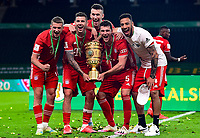 04.07.2020, Fussball DFB Pokal Finale, Bayer 04 Leverkusen - FC Bayern Muenchen emspor,  v.l. Michael Cuisance (FC Bayern Muenchen), Lucas Hernandez (FC Bayern Muenchen), Ivan Perisic (FC Bayern Muenchen), Niklas Suele (FC Bayern Muenchen) mit dem POKAL<br /> <br /> (DFL/DFB REGULATIONS PROHIBIT ANY USE OF PHOTOGRAPHS as IMAGE SEQUENCES and/or QUASI-VIDEO - Editorial Use ONLY, National and International News Agencies OUT)