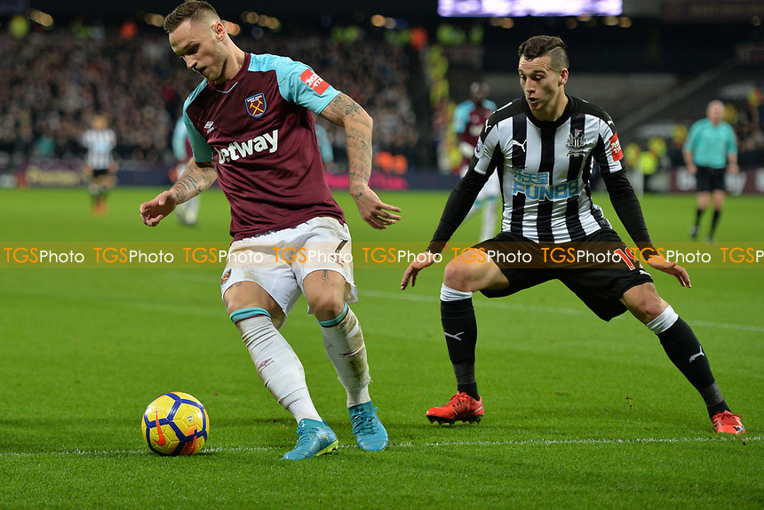 Marko Arnautovic Of Westham and Javi Manquillo Of Newcastle during West Ham United vs Newcastle United, Premier League Football at The London Stadium on 23rd December 2017