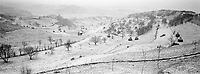 ROMANIA / Maramures / Valeni / December 2002..The central valley of Valeni lies dusted with snow. ..© Davin Ellicson / Anzenberger..