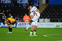 Jordon Garrick of Swansea City celebrates scoring his side's fourth goal during the Carabao Cup Second Round match between Swansea City and Cambridge United at the Liberty Stadium in Swansea, Wales, UK. Wednesday 28, August 2019.