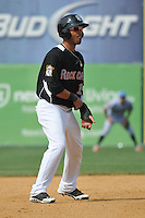 Eddie Rosario (13) of the New Britain Rock Cats leads off second base during a game against the Reading Fightin Phils at New Britain Stadium on July 13, 2014 in New Britain, Connecticut.  (Gregory Vasil/Four Seam Images)