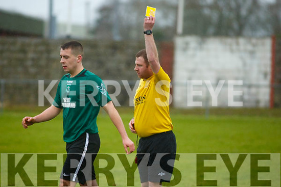 Action from the Tralee Dynamos v Fenit Samphires on Sunday last in Tralee as Samphires Ben Warren picks up a yellow card.