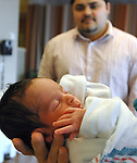 OCEANSIDE,NY- THURSDAY, APRIL 3, 2008: Amanni and Allana Duarte newly born premies with their father Benjamin Duarte (mother did not wish to be photographed) in the NeoNatal Unit of South Nassau Communities Hospital on Thursday April 3, 2008.  Newsday / Jim Peppler