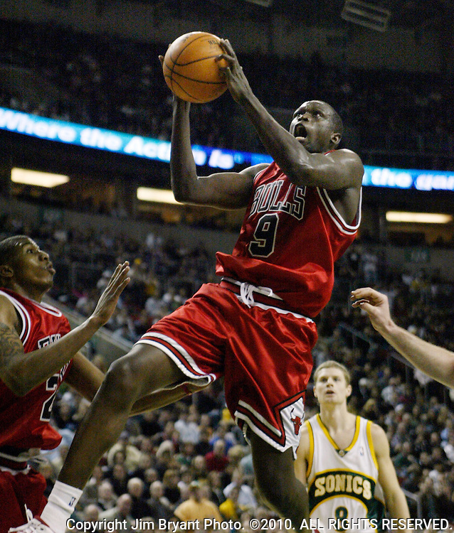 Chicago Bulls' Luol Deng, from Sudan, center, goes to the basket past Seattle SuperSonics' Luke Ridnour, right, in NBA basketball action during the second half Friday, Feb. 2, 2007 in Seattle. Deng scored 27 points in the Bulls 107-101 win over the Sonics. At left is Bulls' Tyrus Thomas.   Jim Bryant Photo. ©2010. All Rights Reserved.