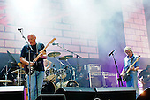 Pink Floyd - L-R: David Gilmour, Nick Mason and Roger Waters - reunited on stage together for the first time in 20 years performing live at the Live 8 concert in Hyde Park, London UK -  02 July 2005.   Photo credit: George Chin/IconicPix