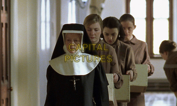 A nun leads stars Dorothy Duffy, Nora Jane Noone and Anne Marie Duff (left to right) in a scene from Peter Mullan's THE MAGDALENE SISTERS.Filmstill - Editorial Use Only.Ref: FB.sales@capitalpictures.com.www.capitalpictures.com.Supplied by Capital Pictures.
