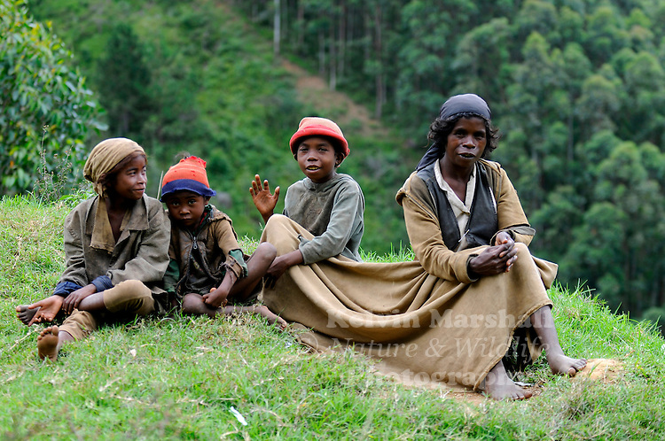 Local Malagasy family gather together to keep warm in the cool mountains. Moramanga - Central Madagascar.