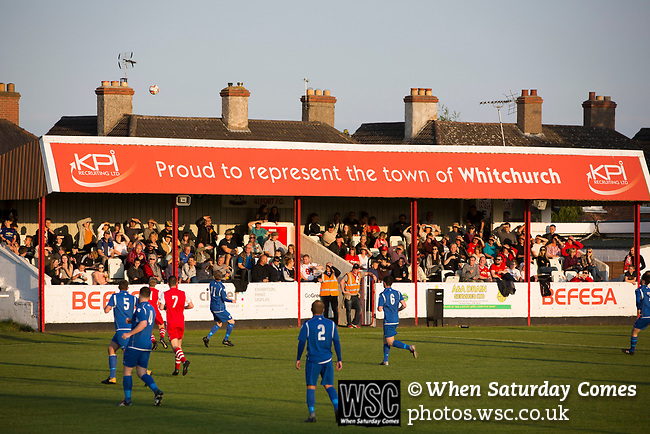 Spectators watching the first-half action at Yockings Park as Whitchurch Alport (in red) hosted Cammell Laird 1907 in the 2017-18 North West Counties Division One play-off final. Alport were formed in 1946 and were named after Alport Farm, Whitchurch, which had been the home of a local footballer Coley Maddocks who had been killed in action in the war. The home team won the match 2-1 watched by a crowd of 733, a club record attendance.
