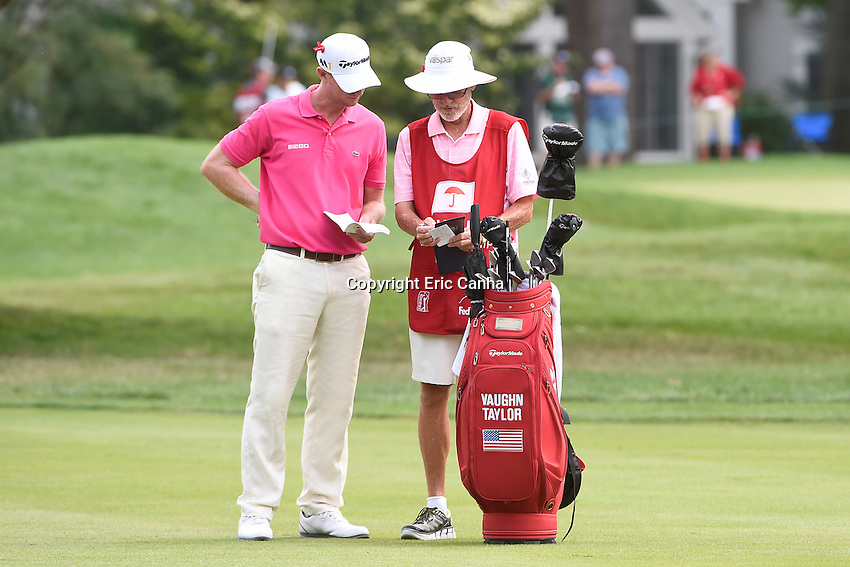 August 6, 2016: Vaughn Taylor reviews his notes with his caddy on the 6th fairway during day three of the PGA Travelers Championship held at TPC River Highlands in Cromwell CT. Eric Canha/CSM