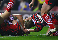 PICTURE BY VAUGHN RIDLEY/SWPIX.COM - Rugby League - Super League - Wigan Warriors v Warrington Wolves - JJB Stadium, Wigan, England - 23/03/12 - Warrington's Brett Hodgson stops Wigan's Michael McIlorum from scoring a try.