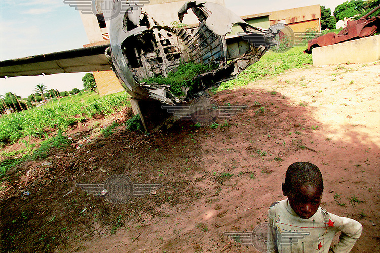 The remains of South African military cargo plane, shot down during the war, in the town center..Luena, Angola. 02 December 2001..Photo ©: J.B. Russell / Panos Pictures