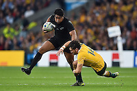 Julian Savea of New Zealand looks to get past Adam Ashley-Cooper of Australia. Rugby World Cup Final between New Zealand and Australia on October 31, 2015 at Twickenham Stadium in London, England. Photo by: Patrick Khachfe / Onside Images