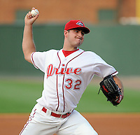 Pitcher Brandon Workman (32) of the Greenville Drive in a game against the Greensboro Grasshoppers on April 26, 2011, at Fluor Field at the West End in Greenville, South Carolina. The second-round pick by the Boston Red Sox in the 2010 First-Year Player Draft, Workman gave up four earned runs and took the loss, 11-0. (Tom Priddy/Four Seam Images)