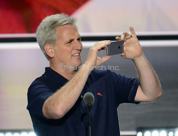 United States House Majority Leader Kevin McCarthy (Republican of California) takes a photo of the arena prior to the opening of the second day of the 2016 Republican National at the Quicken Loans Arena in Cleveland, Ohio on Tuesday, July 19, 2016.<br /> Credit: Ron Sachs / CNP/MediaPunch<br /> (RESTRICTION: NO New York or New Jersey Newspapers or newspapers within a 75 mile radius of New York City)