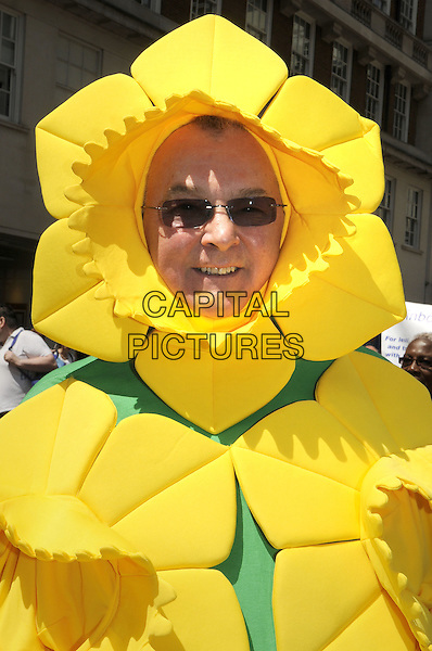 Pride London 2013 Parade through the streets of the capital to support Gay rights. An estimated 25,000 people took part. <br /> London, UK, 29th June 2013.<br /> yellow flower sunglasses costume daffodil <br /> CAP/PP/BK<br /> &copy;Bob Kent/PP/Capital Pictures