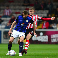 Lincoln City's Michael O'Connor vies for possession with  Crewe Alexandra's Chris Porter<br /> <br /> Photographer Andrew Vaughan/CameraSport<br /> <br /> The EFL Sky Bet League Two - Lincoln City v Crewe Alexandra - Saturday 6th October 2018 - Sincil Bank - Lincoln<br /> <br /> World Copyright &copy; 2018 CameraSport. All rights reserved. 43 Linden Ave. Countesthorpe. Leicester. England. LE8 5PG - Tel: +44 (0) 116 277 4147 - admin@camerasport.com - www.camerasport.com
