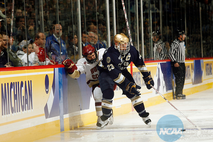 12 APR 2008:  Anthony Aiello (2) of Boston College and Mark Van Guilder (23) of Notre Dame battle along the boards during the Division I Men's Ice Hockey Championship held at the Pepsi Center in Denver, CO.  Boston College defeated Notre Dame 4-1 for the national title.  Jamie Schwaberow/NCAA Photos