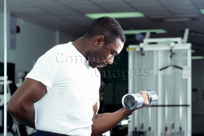 Man working with hand weights in a gym