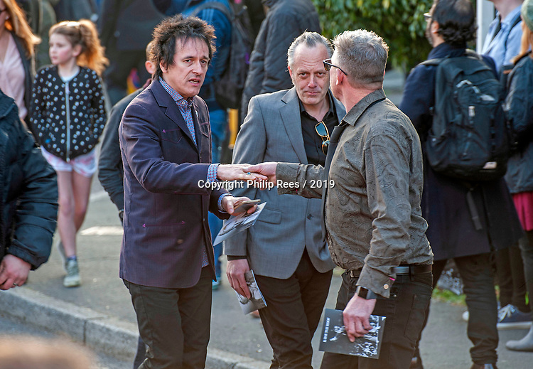 Mourners leaving the service after the funeral of the late Prodigy singer Keith Flint at St Marys Church in Bocking,  Braintree, Essex today. Mourner in dark blue jacket and black hair on left is believed to be Gizz Butt, who was the  live guitarist for The Prodigy in the late 1990s (not confirmed).