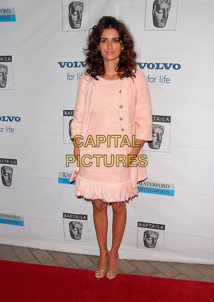 PENELOPE CRUZ.Attends The BAFTA/LA Awards Season Tea Party held at The Four Season's Hotel in Los Angeles, California, USA, January 14 2007..full length pink peach Chanel style dress and matching jacket  curly hair pockets gold shoes.CAP/DVS.©Debbie VanStory/Capital Pictures