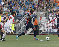 New England Revolution forward Saer Sene (39) dribbles. In a Major League Soccer (MLS) match, the New England Revolution (blue) tied D.C. United (white), 0-0, at Gillette Stadium on June 8, 2013.