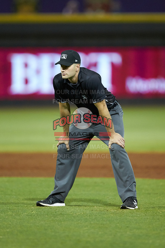 Umpire Dane Poncsak handles the calls on the bases during the Carolina League game between the Carolina Mudcats and the Winston-Salem Dash at BB&T Ballpark on June 1, 2019 in Winston-Salem, North Carolina. The Dash defeated the Mudcats 5-4 in game two of a double header. (Brian Westerholt/Four Seam Images)