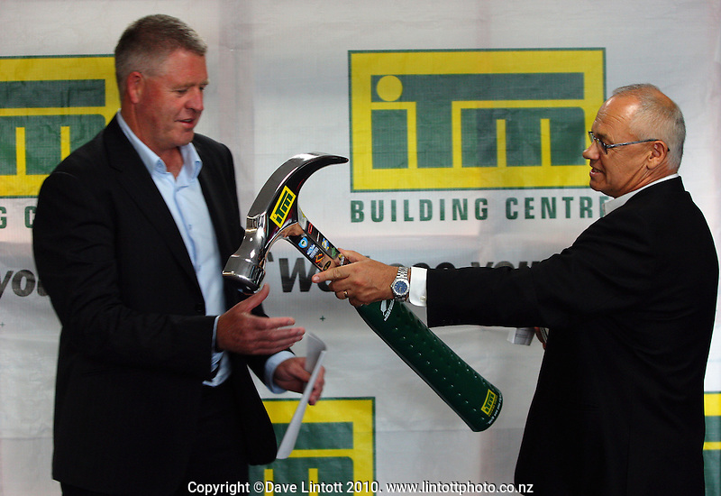 ITM CEO Gordon Buswell hands NZRU CEO Steve Tew a replica hammer. NZRU announces ITM as 2010 provincial rugby sponsor at NZRU Head Office, Wellington, New Zealand on Monday, 15 March 2010. Photo: Dave Lintott / lintottphoto.co.nz