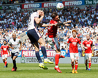 Bolton Wanderers' Aaron Wilbraham heads at goal under pressure from Nottingham Forest's Danny Fox<br /> <br /> Photographer Andrew Kearns/CameraSport<br /> <br /> The EFL Sky Bet Championship - Bolton Wanderers v Nottingham Forest - Sunday 6th May 2018 - Macron Stadium - Bolton<br /> <br /> World Copyright &copy; 2018 CameraSport. All rights reserved. 43 Linden Ave. Countesthorpe. Leicester. England. LE8 5PG - Tel: +44 (0) 116 277 4147 - admin@camerasport.com - www.camerasport.com