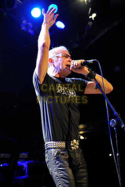 Ivan Doroschuk of Men Without Hats.Performing in concert, Islington Academy, London, England, UK, .1st February 2013..music live on stage concert gig half length black t-shirt glasses microphone singing hand arm .CAP/MAR.© Martin Harris/Capital Pictures.