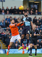 Marcus Bean of Wycombe Wanderers beats Alex Lawless of Luton Town in the air during the Sky Bet League 2 match between Wycombe Wanderers and Luton Town at Adams Park, High Wycombe, England on 6 February 2016. Photo by Andy Rowland.