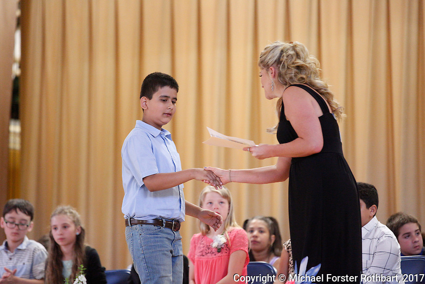 The Oneonta Greater Plains elementary school fifth grade awards ceremony, on June 21, 2017.<br /> &copy; Michael Forster Rothbart Photography<br /> www.mfrphoto.org &bull; 607-267-4893<br /> 34 Spruce St, Oneonta, NY 13820<br /> 86 Three Mile Pond Rd, Vassalboro, ME 04989<br /> info@mfrphoto.org<br /> Photo by: Michael Forster Rothbart<br /> Date:  6/21/2017<br /> File#:  Canon &mdash; Canon EOS 5D Mark III digital camera frame C19249