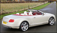 BNPS.co.uk (01202 558833)<br /> Pic: H&amp;H/BNPS<br /> <br /> 2012 Bentley Continental GTC with only 500 miles on the clock - &pound;85,000.<br /> <br /> The &pound;1,000,000 garage sale... a stunning collection of luxury cars seized from the personal collection of a Middle Eastern sheikh has emerged. <br /> <br /> The impressive fleet, comprising Ferrari, Rolls-Royce and Bentley motors, has arrived at auction following a high court ruling against their former owner.<br /> <br /> Due to their unusual history many of the cars, all of which were UK based and have unusually low mileages, are being offered at a bargain price.
