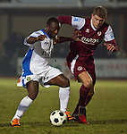 Picture by Arron Gent/Extreme Aperture Photography +44 7545 970036.18/02/2013.Mark Haines (right) of Chelmsford City and Saha Kabba of Havant & Waterville during the Blue Square Bet Blue Square South  League match at Melbourne Stadium, Chelmsford, Essex.