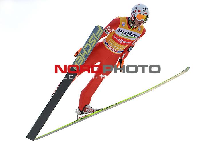 Innsbruck, Austria 03.01.2014 <br /> 2013-14 Vierschanzentournee, <br /> FIS Ski Jumping World Cup <br /> Kamil Stoch of Poland in action during the FIS Ski Jumping World Cup Vierschanzentournee on January 3, 2014 in Innsbruck, Austria.<br /> <br /> Foto &not;&copy; nph / Pier Paolo Piciucco