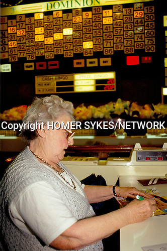 Bingo UK women  playing Bingo alone,  north London. 1990s 90s