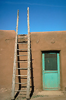 LADDER AND DOOR INSIDE TAOS PUEBLO. TAOS NEW MEXICO USA TAOS PUEBLO..