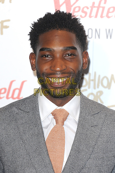 LONDON, ENGLAND - NOVEMBER 27: Tinie Tempah attends the Fashion For Relief Pop Up Launch Party at Westfield Shopping Centre on November 27, 2014 in London, England.<br />  CAP/BEL<br /> &copy;Tom Belcher/Capital Pictures