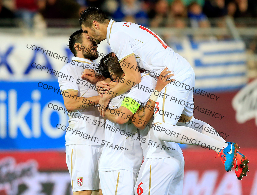 Fudbal<br /> Prijateljski mec-Friendly match<br /> Srbija v Grcka<br /> Nemanja Gudelj (C) celebrate his goal with the Nenad Tomovic (L) Branislav Ivanovic and Stefan Mitrovic (R)<br /> Chania, 18.11.2014.<br /> foto: Srdjan Stevanovic/Starsportphoto &copy;