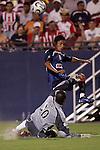 24 July 2007:  Ray Burse (30)  goalie for FC Dallas attempts to block a shot by Alberto Medina of CD Guadalajara.  FC Dallas tied Chivas de Guadalajara 1-1 at Pizza Hut Park in Frisco, Texas, in the opening match of SuperLiga 2007.