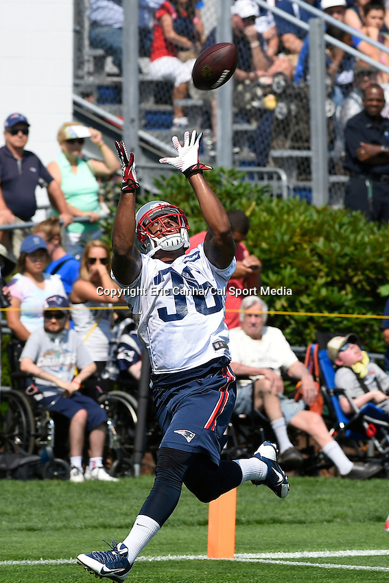 July 25, 2014 - Foxborough, Massachusetts, U.S.- New England Patriots defensive back Kanorris Davis (36) gets under the ball during the New England Patriots training camp held at Gillette Stadium in Foxborough Massachusetts.  Eric Canha/CSM
