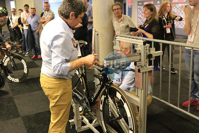 UCI officials check all the bikes measurements during Stage 1 of the 2016 Giro d'Italia, an individual time trial of 9.8km around Apeldoorn, The Nethrerlands. 6th May 2016.<br /> Picture: Eoin Clarke | Newsfile<br /> <br /> <br /> All photos usage must carry mandatory copyright credit (&copy; Newsfile | Eoin Clarke)
